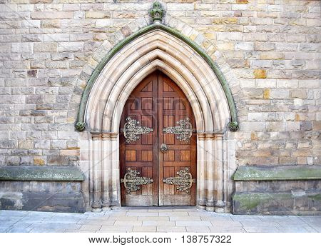 Beautiful architecture of the entry into the old church in city center of Birmingham , United Kingdom