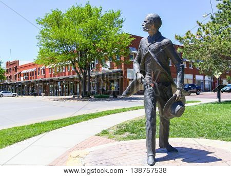 DODGE CITY, USA - MAY 17, 2015: Bronze sculpture of Wyatt Earp as part of the Trail of Fame in the historic district of the city.