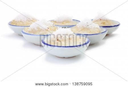 Front cup steamed banana cake in cup on white floor.