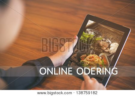 Hand Holding Tablet With Order Food Online With Office Background, Food Online Business Concept.leav