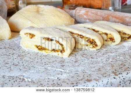 Sweet buns with walnuts. Scones prepared and ready for cooking. The process of making rolls