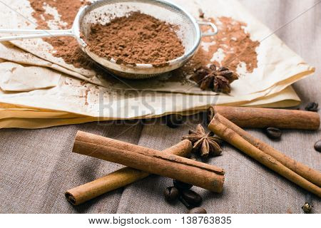 cinnamon coffee beans cocoa and anise on baking paper