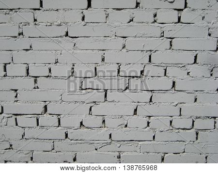 White light grey brick wall background with black spots