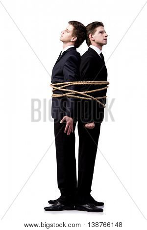 Twin brothers tied up with rope isolated on the white