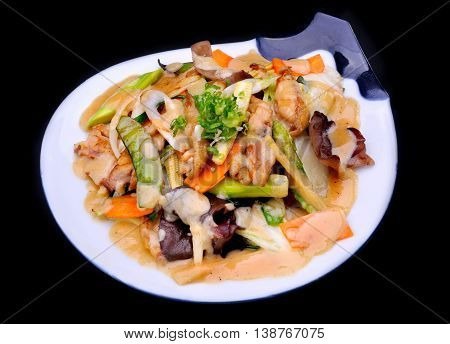 Mixed vegetable and chicken meat fired with Japanese miso serve in white plate