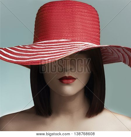 Beauty Woman Face Portrait. Beautiful Model Girl With Perfect Fresh Clean Skin. Woman In A Red Hat.