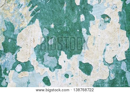Old weathered wall in green