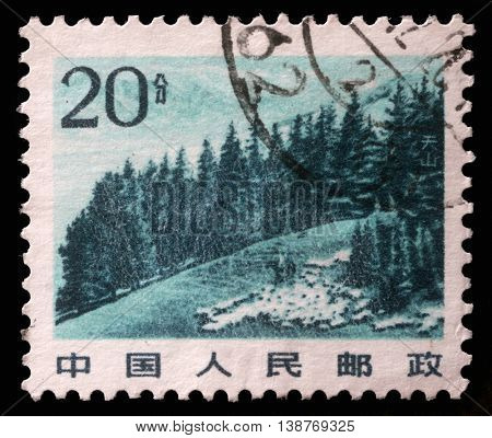 ZAGREB, CROATIA - SEPTEMBER 08: A stamp printed in China shows image of Chinese highland with pine trees in Tianshan Mountain, circa 1983, on September 08, 2012, Zagreb, Croatia