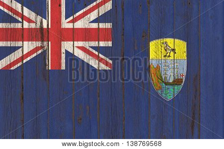 Flag of Saint Helena painted on grungy wood plank background