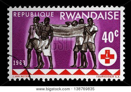 ZAGREB, CROATIA - JULY 03: A stamp printed in Rwanda is dedicated to the 100th anniversary of the International Red Cross, circa 1963, on July 03, 2014, Zagreb, Croatia