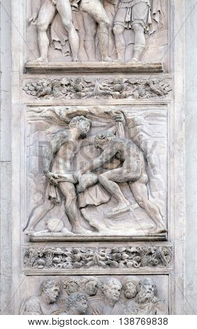 BOLOGNA, ITALY - JUNE 04: The brothers tinged Joseph's coat with the blood by Giacomo Raibolini, right door of San Petronio Basilica in Bologna, Italy, on June 04, 2015