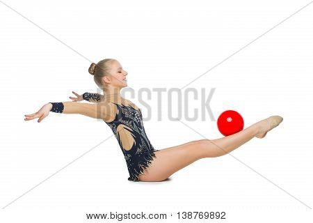 Gymnast girl in beautiful costume making  exercise with red ball. Isolated over white background. Copy space.