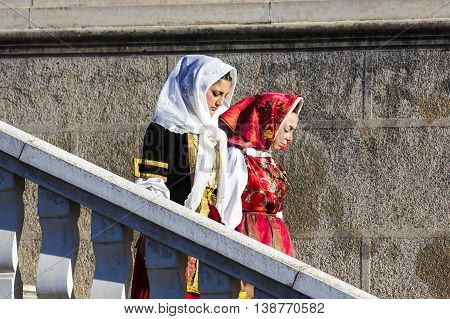 CAGLIARI, ITALY - May 1, 2015: 359 ^ Religious Procession of Sant'Efisio - Sardinia - girls in Sardinian costumes as they descend the stairs