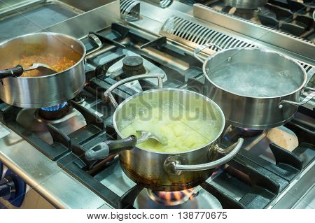 Close Up Of Cooking Many Dishes On The Stove