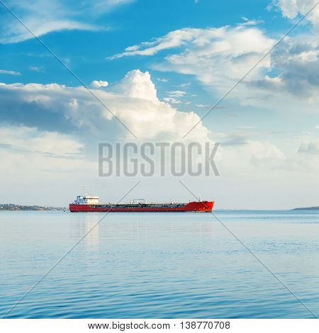 one big ship in river and blue sky with clouds