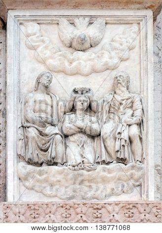 BOLOGNA, ITALY - JUNE 04: The Coronation of the Virgin by Giacomo Scilla, right door of San Petronio Basilica in Bologna, Italy, on June 04, 2015