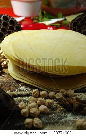 Colorful Indian food - papadum chickpea gram flour and spices on textured wooden table top