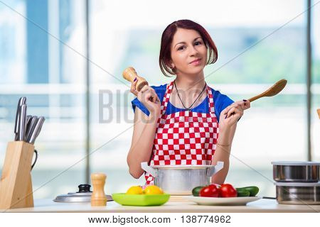 Young cook working in the kitchen