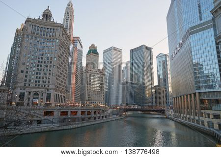 CHICAGO, IL - CIRCA MARCH, 2016: Chicago River at twilight. The Chicago River is a system of rivers and canals that runs through the city of Chicago, including its center.