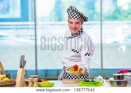 Male cook preparing food in the kitchen