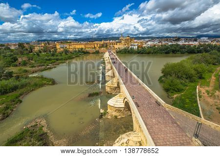 Calahorra Tower overlook on the Roman Bridge, on the Guadalquivir river and Cordoba skyline in Andalusia, Spain.