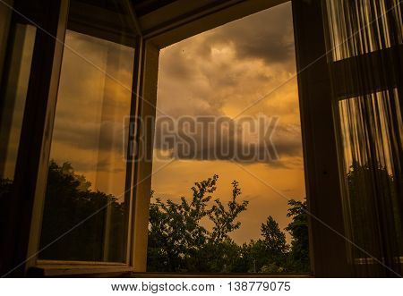Modern residential window with storm clouds outside nature element environment