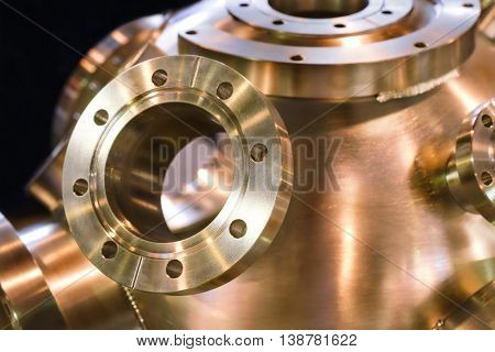 Flanged vacuum equipment. Shiny copper surface.. A metal surface treated