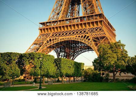 Eiffel Tower closeup in park as the famous city landmark in Paris