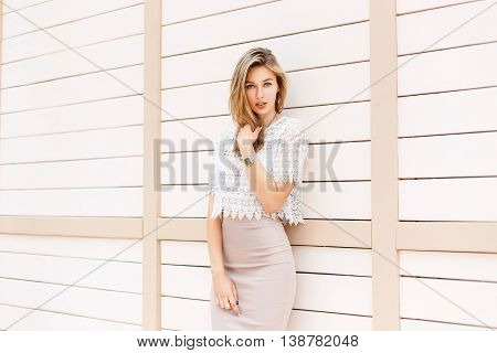 Beautiful Stylish Girl In White Vintage Blouse With Lace On The Background Of Wooden Wall