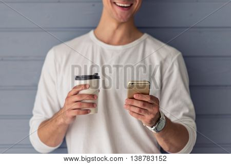 Handsome Young Man With Gadget