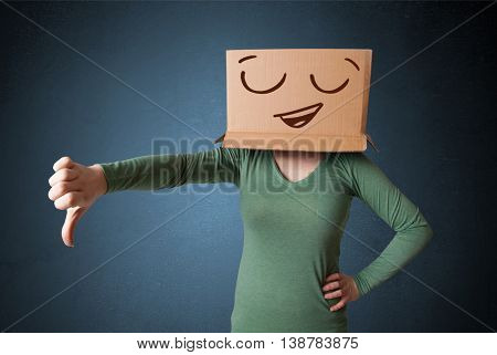 Young woman standing and gesturing with a cardboard box on her head with smiley face