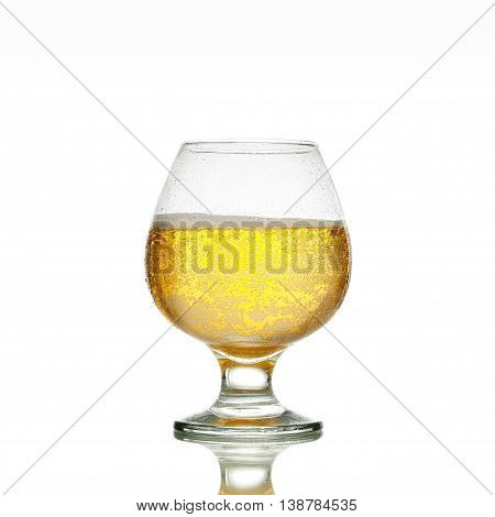 Beer In A Glass On Glossy Surface With Drops Isolated On Background