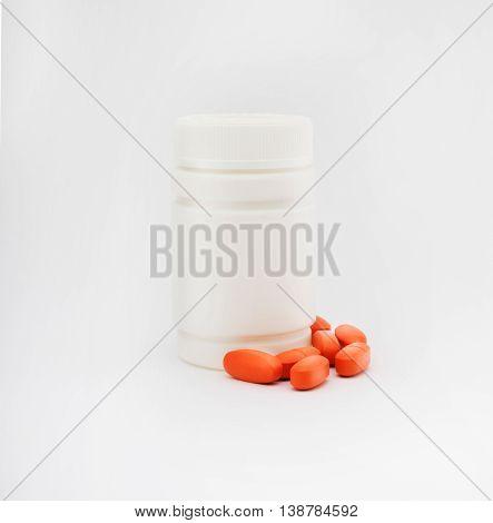 Medicine Bottle With Red Pills On White Background. White Plastic Bottle, Cardboard Packaging. Medic