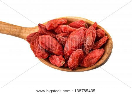Goji berry. Dried goji berries on a wooden spoon isolated on white with clipping path