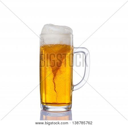 Frosty glass of light beer set isolated on a white background.