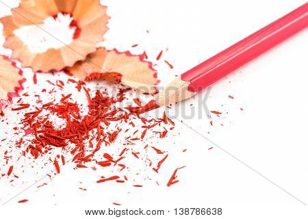 Colour pencill with sharpening shavings on white background