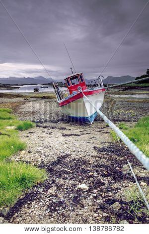Crab Fishing Boat at Low Tide on Scottish Coast