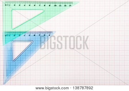 drawing tools on blue graph paper with copy space