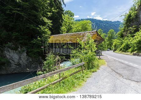 Traditional Covered Wood Bridge in mountain Switzerland