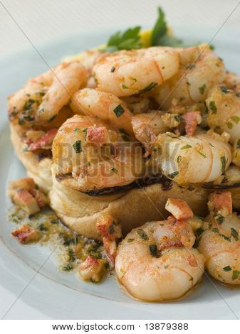 Toasted Brioche topped with Prawns cooked In Lobster Garlic Butter