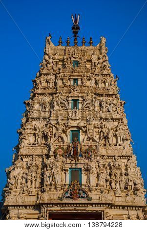 An ancient Hindu temple in Pushkar in India. Temple on a background blue sky.