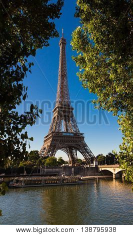 The Eiffel tower is one of the most visited monuments in the world. It located on the bank of the Seine river in Paris