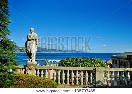 Marble sculpture on terrace with background of the sea