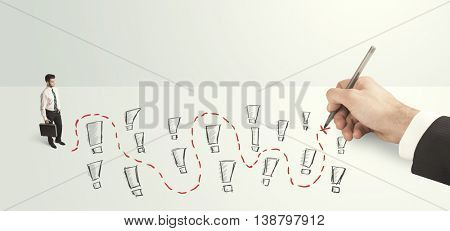 pensive businessman in front of hand drawn labyrinth