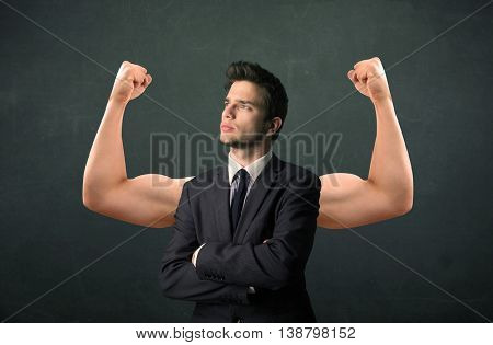 Young businessman wondering with strong and muscled arms concept