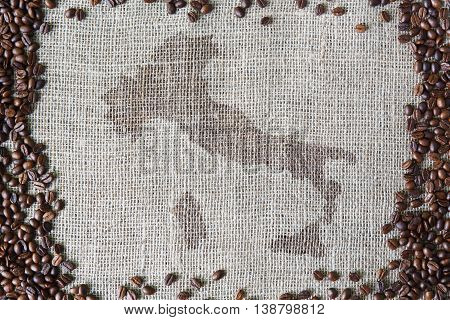 Burlap texture with coffee beans border. Sack cloth background with Italy map in the middle. Brown natural sackcloth canvas. Seeds at hessian textile