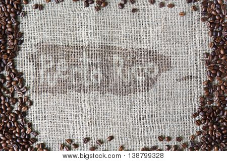 Burlap texture with coffee beans border. Sack cloth background with Puerto Rico title in spot in the middle. Brown natural sackcloth canvas. Seeds at hessian textile