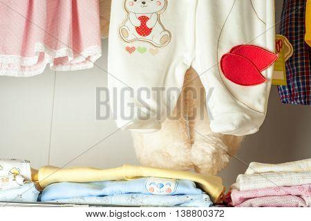 Children's Clothing For Newborns At Shelf In Shop
