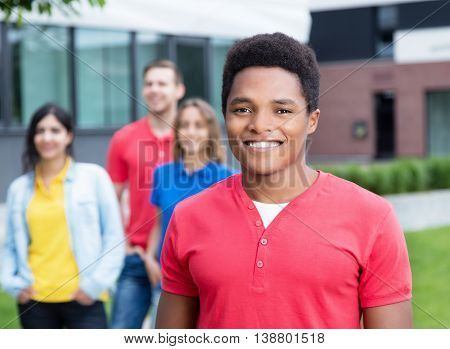 Happy african american guy and multiethnic friends outdoor in the summer