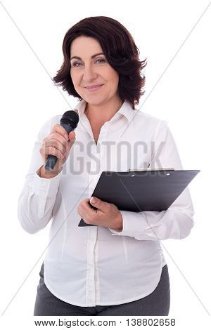Portrait Of Mature Female Reporter With Microphone And Clipboard Isolated On White